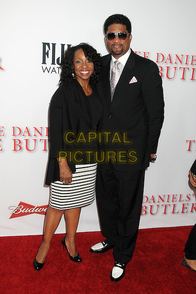 Gladys Knight, William McDowell<br /> &quot;Lee Daniels' The Butler&quot; Los Angeles Premiere held at Regal Cinemas L.A. Live, Los Angeles, California, USA.<br /> August 12th, 2013<br /> full length black top cardigan white stripe skirt suit sunglasses shades goatee facial hair married husband wife <br /> CAP/ADM/BP<br /> &copy;Byron Purvis/AdMedia/Capital Pictures