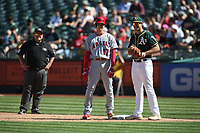 OAKLAND, CA - SEPTEMBER 20:  Shohei Ohtani #17 of the Los Angeles Angels of Anaheim stands on first base and talks with Oakland Athletics first baseman Matt Olson #38 during the game at the Oakland Coliseum on Thursday, September 20, 2018 in Oakland, California. (Photo by Brad Mangin)
