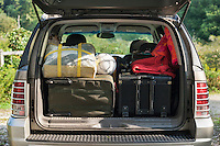 SUV car packed for vacation trip.