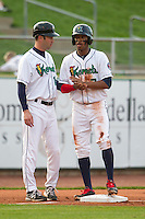 Cedar Rapids Kernels outfielder Byron Buxton #7 talks with manager Jake Mauer #12 during a game against the Lansing Lugnuts at Veterans Memorial Stadium on April 29, 2013 in Cedar Rapids, Iowa. (Brace Hemmelgarn/Four Seam Images)