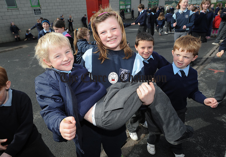 Chloe Sheerin gets to grips with Darragh O Neill during sos break  at St Aidan's National School, Shannon. Photograph by John Kelly.