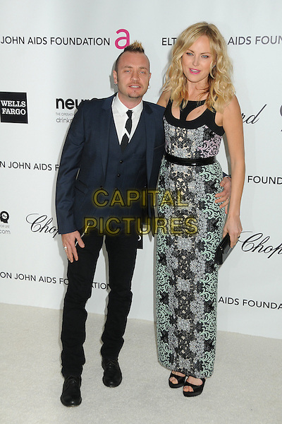 Roberto Zincone & Malin Akerman .20th Annual Elton John Academy Awards Viewing Party held at West Hollywood Park, West Hollywood, California, USA..February 26th, 2012.oscars full length tall short married husband wife blue black suit green blue print dress purple pink.CAP/ADM/BP.©Byron Purvis/AdMedia/Capital Pictures.