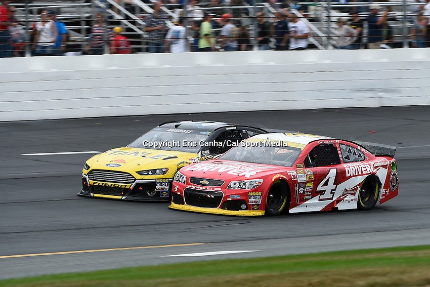 September 21, 2014 - Loudon, New Hampshire, U.S. - Sprint Cup Series driver Kevin Harvick (4) and driver Marcos Ambrose (9) bump and battle in the Nascar Sprint Cup Series Sylvania 300 race held at the New Hampshire Motor Speedway in Loudon, New Hampshire.   Eric Canha/CSM