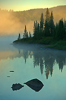 Northern lake in fog at sunrise<br />Chibougameau<br />Quebec<br />Canada