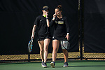 (L-R) Courtney Meredith and Joanna Zalewski of the Wake Forest Demon Deacons discuss strategy during their doubles match against the North Carolina Tar Heels at the Wake Forest Tennis Center on March 29, 2017 in Winston-Salem, North Carolina. The Tar Heels defeated the Demon Deacons 6-1.  (Brian Westerholt/Sports On Film)