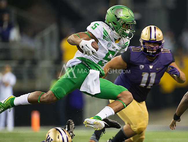 Taj Griffin goes airborne against the Huskies.