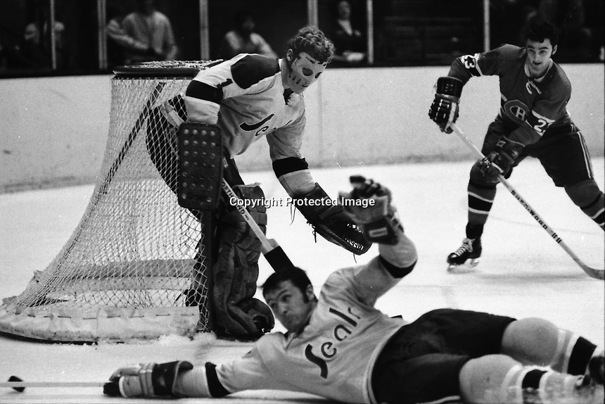 California Golden Seals goalie Gary Smith,and Dick Mattiussi against the Montreal Canadiens...(1970 photo/Ron Riesterer)