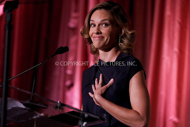 WWW.ACEPIXS.COM . . . . . ....December 4 2009, Hollywood....Actress Hilary Swank at the Hollywood Reporter's Annual Women in Entertainment Breakfast at the Beverly Hills Hotel on December 4, 2009 in Beverly Hills, California.....Please byline: JOE WEST- ACEPIXS.COM.. . . . . . ..Ace Pictures, Inc:  ..(646) 769 0430..e-mail: info@acepixs.com..web: http://www.acepixs.com