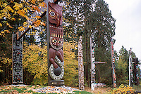 Carved Coast Salish Totem Gateway and Totem Poles at Brockton Point in Stanley Park, Vancouver, BC, British Columbia, Canada, Autumn / Fall