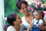 African American grandmother daughter and grandson portrait at home on the porch