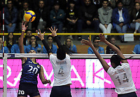 BOGOTÁ-COLOMBIA, 07-01-2020: Winderlys Medina y Aleoscar Blanco de Venezuela, intentan un bloqueo al ataque de balón a Verónica Pasos de Colombia, durante partido entre Venezuela y Colombia en el Preolímpico Suramericano de Voleibol, clasificatorio a los Juegos Olímpicos Tokio 2020, jugado en el Coliseo del Salitre en la ciudad de Bogotá del 7 al 9 de enero de 2020. / Winderlys Medina and Aleoscar Blanco from Venezuela, tries to block the attack the ball to Veronica Pasos from Colombia, during a match between Venezuela and Colombia, in the South American Volleyball Pre-Olympic Championship, qualifier for the Tokyo 2020 Olympic Games, played in the Colosseum El Salitre in Bogota city, from January 7 to 9, 2020. Photo: VizzorImage / Luis Ramírez / Staff.