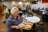 NWA Democrat-Gazette/DAVID GOTTSCHALK Susan Dearing, serves a tray of beans Wednesday, November 7, 2018, to a group during the weekly lunch hour bean dinner in the renovated dining and event room at the Shelton Tucker Craft American Legion Post 27 in Fayetteville. Funds raised from the meals go towards operational costs and support the post's outreach efforts.