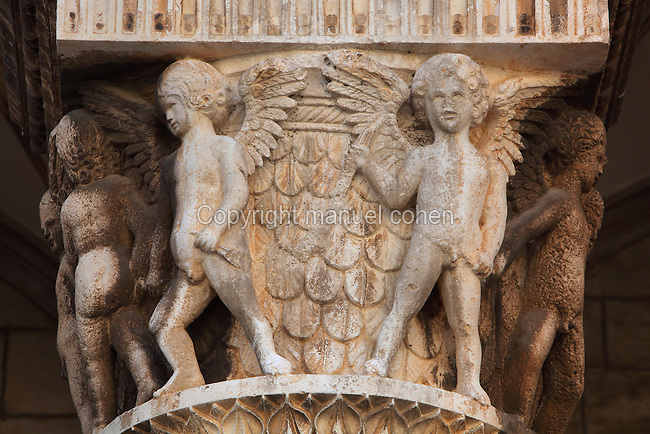 Carved capital with cherubs, 15th century by Salvi di Michele in Renaissance style, on the porch on the facade of the Rector's Palace, built in the 15th century by Onofrio di Giordano della Cava, in Gothic and Renaissance style, Dubrovnik, Croatia. The city developed as an important port in the 15th and 16th centuries and has had a multicultural history, allied to the Romans, Ostrogoths, Byzantines, Ancona, Hungary and the Ottomans. In 1979 the city was listed as a UNESCO World Heritage Site. Picture by Manuel Cohen