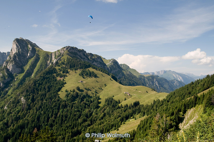 Hang glider flies near Lake Annecy in the French Alps