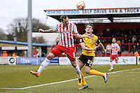 Luke Wilkinson of Stevenage and John Marquis of Northampton Town during the Sky Bet League 2 match between Stevenage and Northampton Town at the Lamex Stadium, Stevenage, England on 19 March 2016. Photo by David Horn / PRiME Media Images.