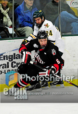 26 November 2010: Northeastern University Huskies' defenseman Jamie Oleksiak, a Freshman from Toronto, Ontario, in action on the boards against University of Vermont Catamount forward Tobias Nilsson-Roos, a Sophomore from Malmo, Sweden, at Gutterson Fieldhouse in Burlington, Vermont. The Huskies came back from a 2-0 deficit to earn a 2-2 tie against the Catamounts. Mandatory Credit: Ed Wolfstein Photo