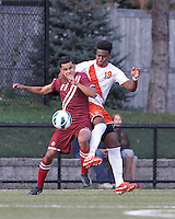 Boston College forward/midfielder Diego Medina-Mendez (11) challenges Syracuse University defender Tyler Hilliard (19) for the ball.Boston College (maroon) defeated Syracuse University (white/orange), 3-2, at Newton Campus Field, on October 8, 2013.