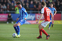 Blackpool's Gary Madine under pressure from Fleetwood Town's Lewis Gibson<br /> <br /> Photographer Kevin Barnes/CameraSport<br /> <br /> The EFL Sky Bet League One - Fleetwood Town v Blackpool - Saturday 7th March 2020 - Highbury Stadium - Fleetwood<br /> <br /> World Copyright © 2020 CameraSport. All rights reserved. 43 Linden Ave. Countesthorpe. Leicester. England. LE8 5PG - Tel: +44 (0) 116 277 4147 - admin@camerasport.com - www.camerasport.com