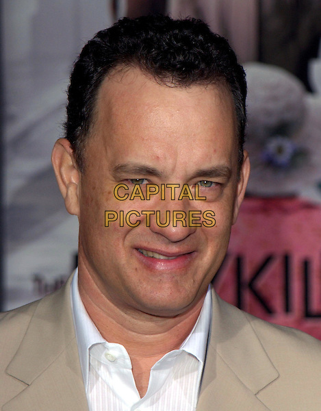 TOM HANKS  .Los Angeles Premiere of The LadyKillers held at The El Capitan Theatre in Hollywood, California .12 March 2004.*UK Sales Only*.portrait, headshot .www.capitalpictures.com.sales@capitalpictures.com.©Capital Pictures.