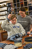 STITCH IN TIME<br />Duncan Myers, 14, and his mom, Gena Myers of Rogers, work Friday Jan. 10 2-19 on a sewing project together in a class at Hillfolk textile studio in Bentonville. Students learned to sew and patch denim. Classes are held weekly that focus on a variety of sewing and knitting techniques. Check out nwaonline.com/200111Daily/ for today's photo gallery.<br />(NWA Democrat-Gazette/Flip Putthoff)