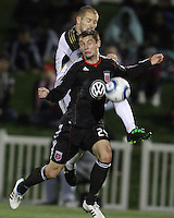 Blake Brettechneider(29) of D.C. United is challenged from behind by Jordan Harvey(2) of the Philadelphia Union during a play-in game for the US Open Cup tournament at Maryland Sportsplex, in Boyds, Maryland on April 6 2011. D.C. United won 3-2 after overtime penalty kicks.