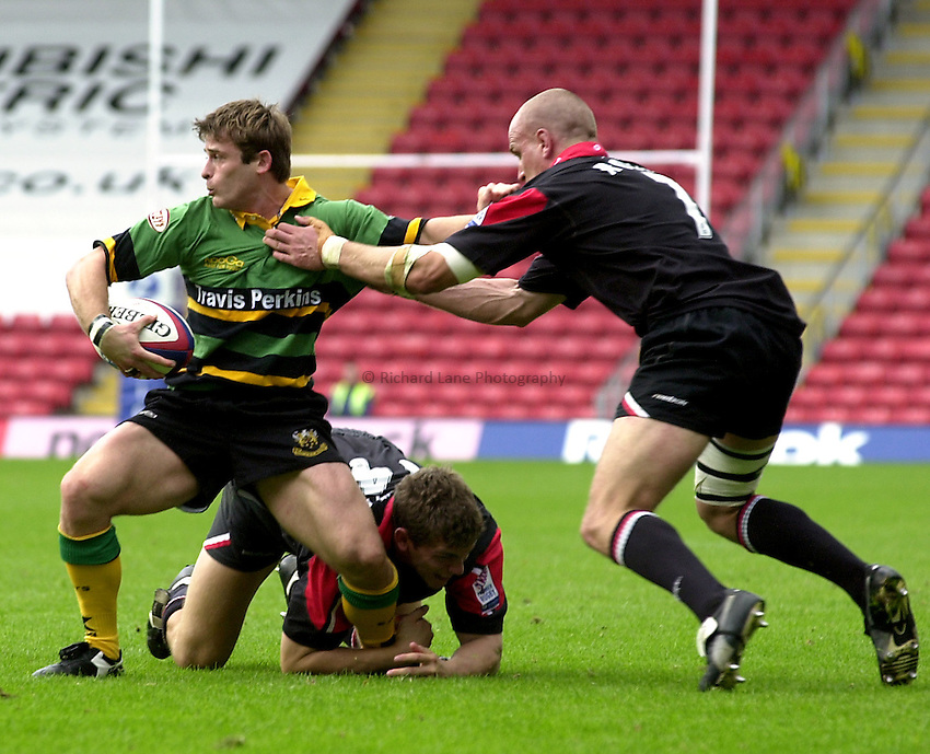 Photo. Richard Lane.Saracens v Northampton Saints. Zurich Premiership. 28/09/2002..Oriol Ripol is tackled.