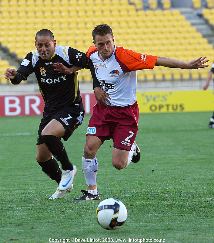 Leo Bertos and Andrew Packer chase the ball during the A-League football match between the Wellington Phoenix and Queensland Roar at Westpac Stadium, Wellington. Sunday, 26 October 2008. Photo: Dave Lintott / lintottphoto.co.nz