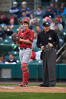 Lehigh Valley IronPigs catcher Logan Moore (11) and umpire Chad Whitson during a game against the Rochester Red Wings on May 15, 2015 at Frontier Field in Rochester, New York.  Rochester defeated Lehigh Valley 5-4.  (Mike Janes/Four Seam Images)