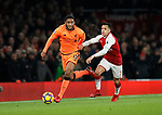 Arsenal's ALexis Sanchez tussles with Liverpool's Joe Gomez during the premier league match at the Emirates Stadium, London. Picture date 22nd December 2017. Picture credit should read: David Klein/Sportimage