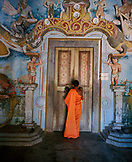 SRI LANKA, Asia, rear view of a monk standing in front of temple's door