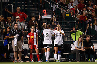 Portland Thorns forward Alex Morgan (13) gets subbed in for forward Danielle Foxhoven (9). The Portland Thorns defeated the Western New York Flash 2-0 during the National Women's Soccer League (NWSL) finals at Sahlen's Stadium in Rochester, NY, on August 31, 2013.