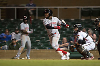 Scottsdale Scorpions shortstop Alfredo Rodriguez (3), of the Cincinnati Reds organization, follows through on his swing in front of catcher Daulton Varsho (8) during an Arizona Fall League game against the Salt River Rafters at Salt River Fields at Talking Stick on October 11, 2018 in Scottsdale, Arizona. Salt River defeated Scottsdale 7-6. (Zachary Lucy/Four Seam Images)