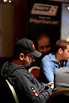 Team Pokerstars.net Pro.Daniel Negreanu competes at a table near a poster with his image on it during the NAPT Venetian event.