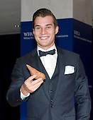 Marcus Johns poses with a sweet potato as he arrives for the 2015 White House Correspondents Association Annual Dinner at the Washington Hilton Hotel on Saturday, April 25, 2015.<br /> Credit: Ron Sachs / CNP
