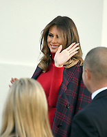 First lady Melania Trump waves to the press as she and son Barron accept the White House Christmas tree on the North Portico of the White House in Washington, DC on Monday, November 20, 2017.  The tree will stand in the Blue Room.<br /> Credit: Ron Sachs / CNP /MediaPunch /NortePhoto.com