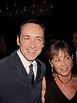Kevin Spacey and Guest Attending the Tony Awards at the Gershwin Theatre in New York City.<br />June 6, 1999