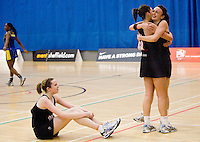 11 MAR 2009 - SHEFFIELD,GBR - Jo Harten watches as teammates Lauren Doyle and Katy Rose celebrate Loughborough University's victory over the University of Bath in the Netball Championship Final at the 2009 BUCS Championships.(PHOTO (C) NIGEL FARROW)