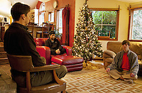 USA. Washington state. Fall City. ReStart Internet Addiction Recovery program at Heavensfield Retreat Center. Shlok (C) is 22 years old and is a citizen from India. He seats in a red sofa and meditates during his Minfulness session under the supervision of Paul (L). John(R) is 20 years old and is american. Shook and John have both dropped out of university because they were highly addictive online video gamers on internet. ReStart is an unique intensive onsite program which offers to participants an opportunity to stay in a retreat center designed to promote insight and renewal, disconnect from digital distractions, and engage in coaching and mentoring while building a blue print for change. The three to six-month reStart program, the first of this kind in the United States, works to help men over 18, suffering from problematic internet, video game, social media and technology use by teaching positive and sustainable lifestyle change in a serene, rural environment surrounded by nature. 11.12.2014 © 2014 Didier Ruef