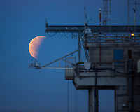 "January 31, 2018- San Diego, California, USA-   A Super Blue Blood Moon sets behind the Scripps Pier in San Diego, CA, on Jan. 31, 2018. The moon was about 14 percent brighter than usual making it a super moon and is the second full moon of the month, commonly known as a ""blue moon."" The super blue moon will passed through Earth's shadow to give viewers a total lunar eclipse. While the Moon is in the Earth's shadow it will take on a reddish tint, known as a ""blood moon.""   (Photo Credit: © K.C. ALFRED/ZUMA PRESS)"