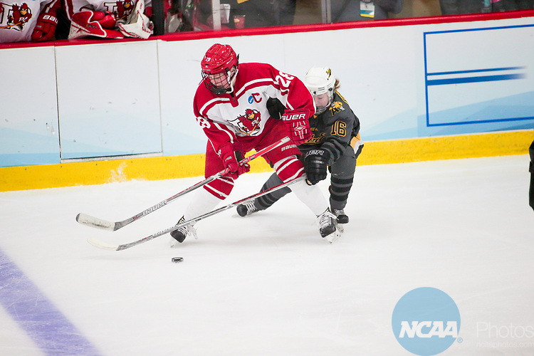 ADRIAN, MI - MARCH 18: Erin Brand (28) of Plattsburgh State University and Bailey Robertson (16) of Adrian College fight for possession during the Division III Women's Ice Hockey Championship held at Arrington Ice Arena on March 19, 2017 in Adrian, Michigan. Plattsburgh State defeated Adrian 4-3 in overtime to repeat as national champions for the fourth consecutive year. by Tony Ding/NCAA Photos via Getty Images)