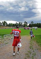 Jul 31, 2009; Flagstaff, AZ, USA; Arizona Cardinals tight end Anthony Becht heads off the field following training camp on the campus of Northern Arizona University. Mandatory Credit: Mark J. Rebilas-