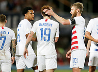 GEORGETOWN, GRAND CAYMAN, CAYMAN ISLANDS - NOVEMBER 19: Josh Sargent #19 of the United States celebrates his goal with team mates Weston McKennie #8 and Tim Ream #13 during a game between Cuba and USMNT at  Truman Bodden Sports Complex on November 19, 2019 in Georgetown, Grand Cayman.