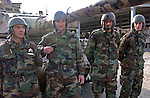 (Tuzla, Bosnia, 02/06/02) Members Bosnian military meet with members of the Massachusetts Army National Guard  in the aftermath of ethnic cleansing and prevent a resumption of violence that ravaged the former Yugoslav state by provide security for displaced residents returning to rebuild their shattered homes in Northern Bosnia on Wednesday, February 06, 2002. Staff photo by Christopher Evans
