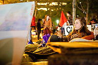 "Nicole Von Haack rests for a minute as the protest ""Occupy Wall Street"" continues into its third week in Zuccotti Park in New York City on October 6, 2011."