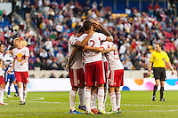 New York Red Bulls players including Jonny Steele (22) and Kosuke Kimura (27) celebrate an FC Dallas own goal. The New York Red Bulls defeated FC Dallas 1-0 during a Major League Soccer (MLS) match at Red Bull Arena in Harrison, NJ, on September 22, 2013.