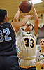 Brittny Membreno #33 of Masspequa, right, looks to drive to the net as Jamie Behar #32 of Oceanside contests her shot during a Nassau County Conference AA-1 varsity girls basketball game at Massapequa High School on Friday, Jan. 12, 2018. Membreno scored 16 points, including eight in the third quarter. Massapequa won by a score of 65-37.