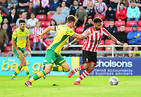 Lincoln City's Bruno Andrade vies for possession with Norwich City's Christoph Zimmerman<br />