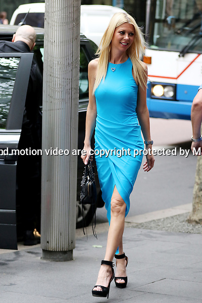 12 NOVEMBER 2014 SYDNEY AUSTRALIA<br /> <br /> EXCLUSIVE PICTURES<br /> <br /> Tara Reid pictured arriving at Seven's Martin Place Studio in a blue dress and later leaving in a white dress. Tara was accompanied by her towering bodyguard.<br /> <br /> *No web use without clearance*.<br /> MUST CONTACT PRIOR TO USE <br /> +61 2 9211-1088. <br /> <br /> Matrix Media Group.Note: All editorial images subject to the following: For editorial use only. Additional clearance required for commercial, wireless, internet or promotional use.Images may not be altered or modified. Matrix Media Group makes no representations or warranties regarding names, trademarks or logos appearing in the images.