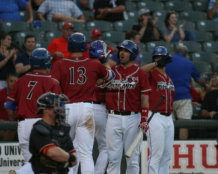 Round Rock Express first baseman Brett Nicholas congratulates Joey Gallo after Gallo's three-run home run in the bottom of the third inning of the Minor League Baseball game between the Round Rock Express, wearing promotional Round Rock Fire Ants jerseys, and the Fresno Grizzlies at Dell Diamond in Round Rock on Thursday, July 21, 2016. Round Rock won 3-0.
