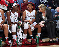 STANFORD, CA - February 27, 2014: Stanford Cardinal's Chiney Ogwumike, Amber Orrange, and assistant coach Kate Paye during Stanford's 83-60 victory over Washington at Maples Pavilion.